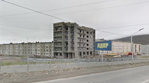 Unfinished building & LDPR advertising (Magadan, Russia)